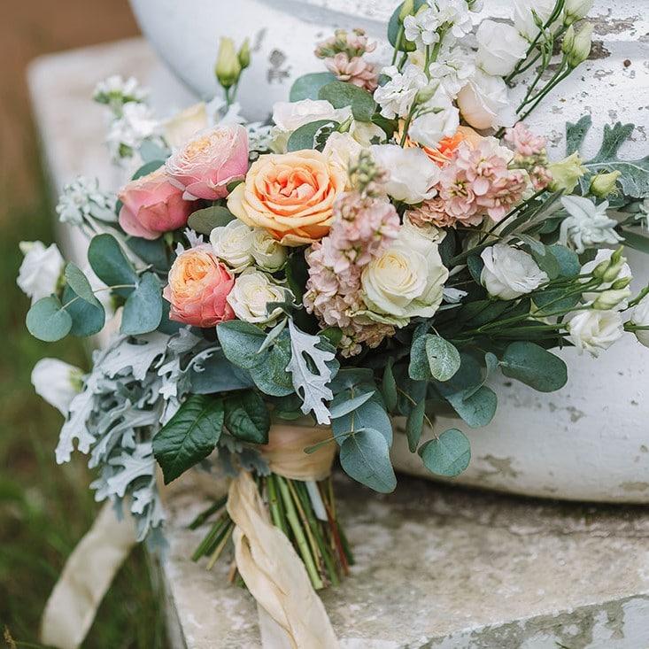 Peach coloured wedding bouquet